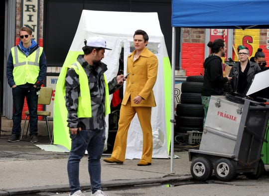 "An actor in period clothes is pictured as movie production crews work on School Street in Yonkers, as they film ""The Sopranos"" prequel movie ""The Many Saints of Newark"", April 30, 2019."