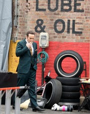 "Actor Alessandro Nivola takes a smoke break as movie production crews work on School Street in Yonkers, as they film ""The Sopranos"" prequel movie ""The Many Saints of Newark"", April 30, 2019."