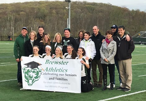 2019 Brewster senior girls lacrosse players with their families