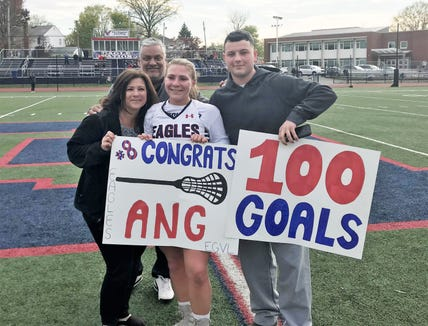 Eastchester's Angelina Porcello joins family members after notching her 100th career varsity goal 2019.