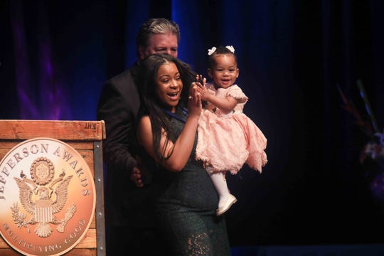 """Giovanna Andrews the stage with her daughter after winning a medal for """"Outstanding Service Benefitting Local Communities"""" during the seventh annual Jefferson Awards Awards Ceremony Monday, April 29, 2019, at The Queen Theater in Wilmington DE."""