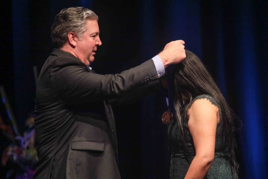"News Journal President Tom Donovan presented a medal to Giovanna Andrews for ""Outstanding Service Benefitting Local Communities"" during the seventh annual Jefferson Awards Awards Ceremony Monday, April 29, 2019, at The Queen Theater in Wilmington DE."