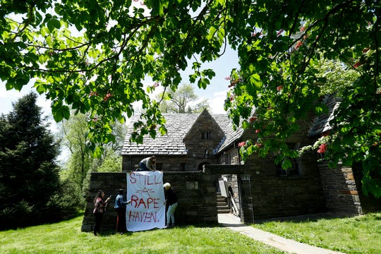 Swarthmore College students hang a banner near the Phi Psi fraternity house during a sit-in, Monday, April 29, 2019, in Swarthmore, Pa. Students at the suburban Philadelphia college have occupied the on-campus fraternity house in an effort to get it shut down after documents allegedly belonging to Phi Psi surfaced this month containing derogatory comments about women and the LGBTQ community and jokes about sexual assault.