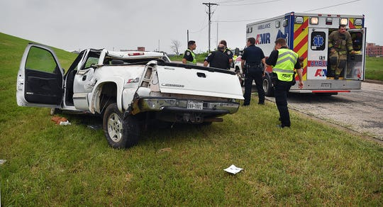 Wichita Falls Police investigate a rollover accident at the Emmanuel Davis Overpass and Martin Luther King Jr. Drive Tuesday morning.