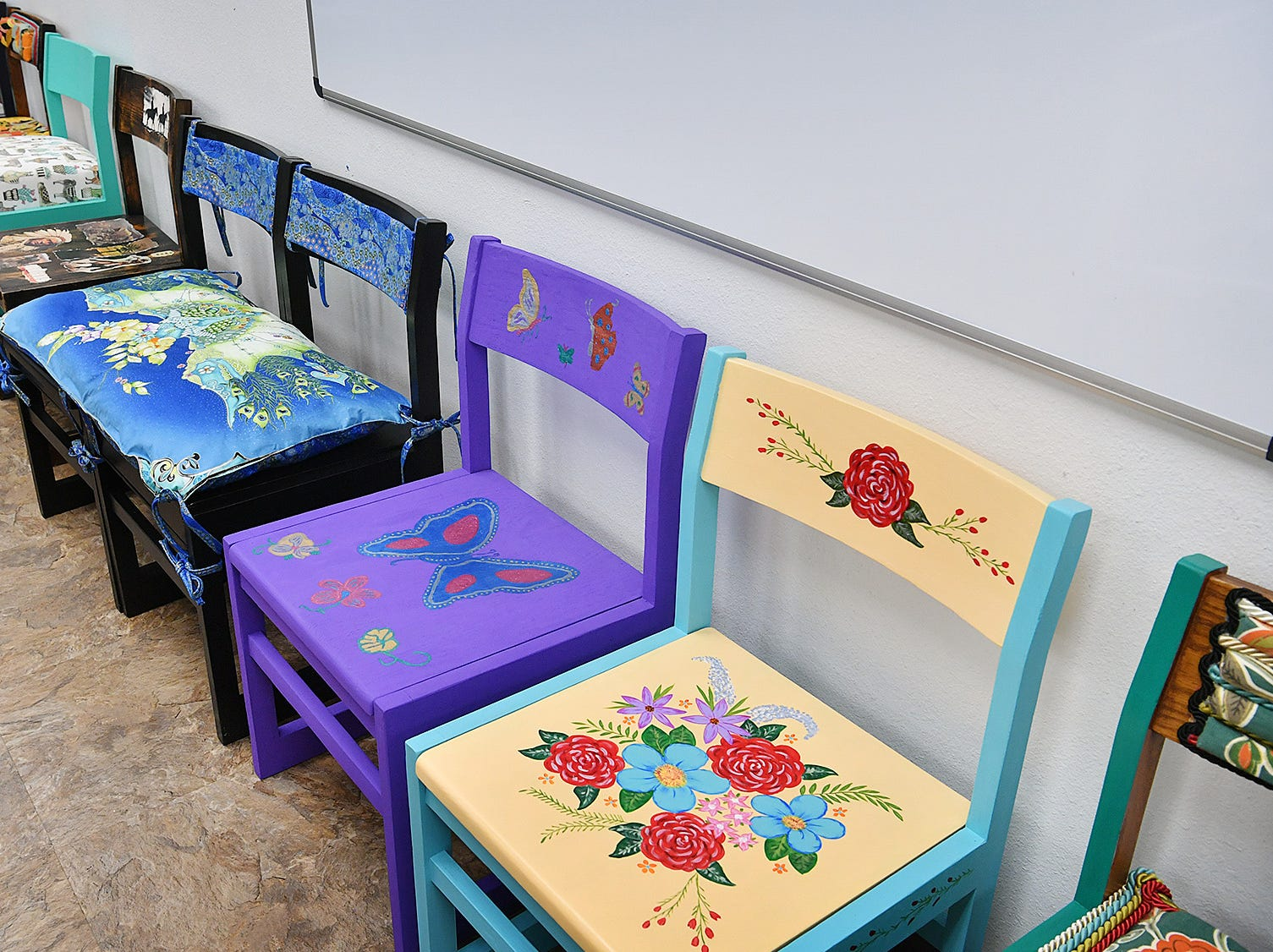 A wide variety of artistic styles are represented in the approximately 40 chairs in the Wichhita Falls Public Library Chair-ity Art Auction.
