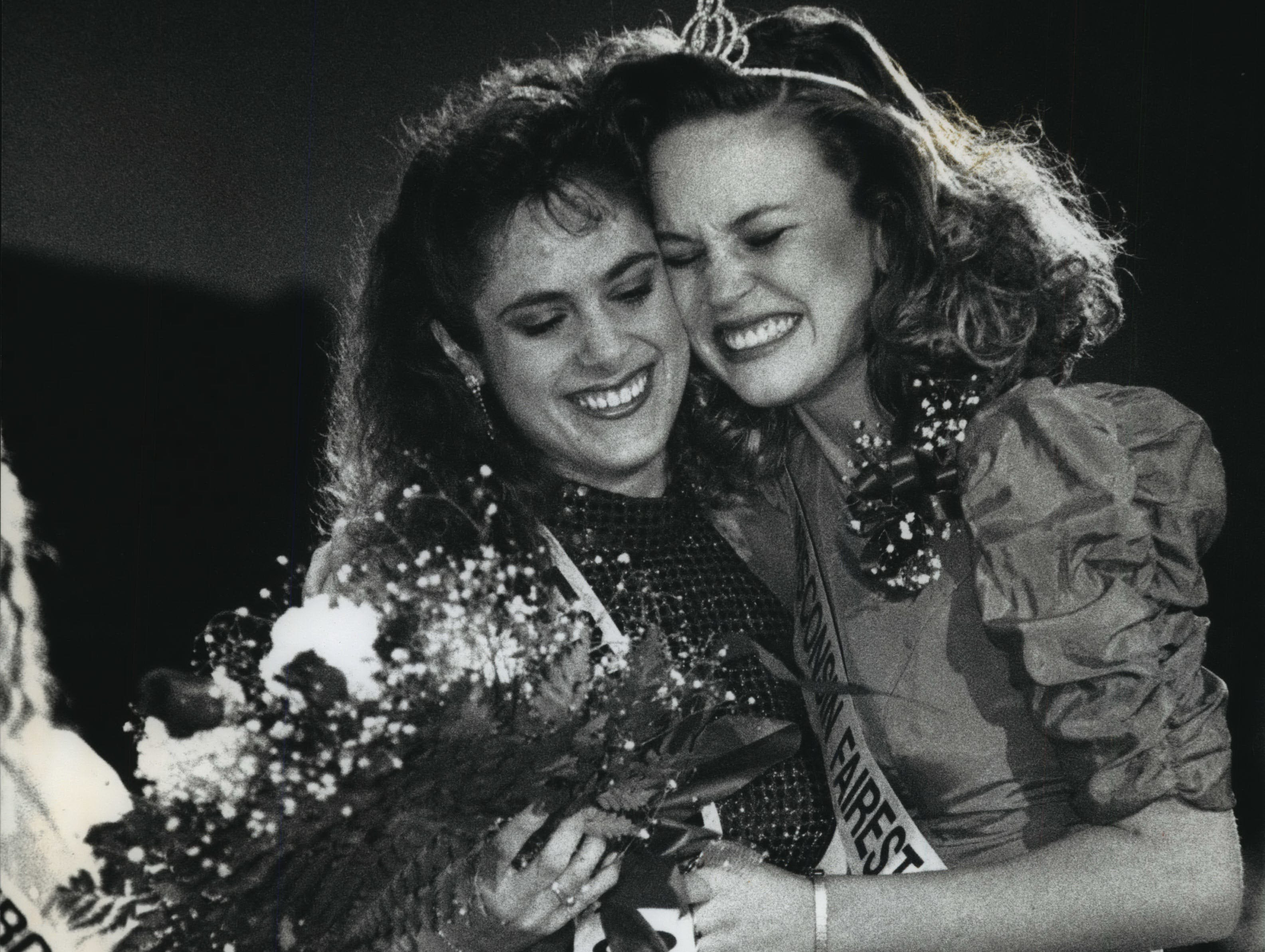 Sue Adams (left), 21, gets a congratulatory hug from Michelle Beilke, 1992 Fairest of the Fairs, after Adams was announces as the 1993 Wisconsin Fairest of the Fairs Wednesday at the Wisconsin Association of Fairs convention at the Hyatt Regency Milwaukee. Both represented the Fond du Lac County Fair.