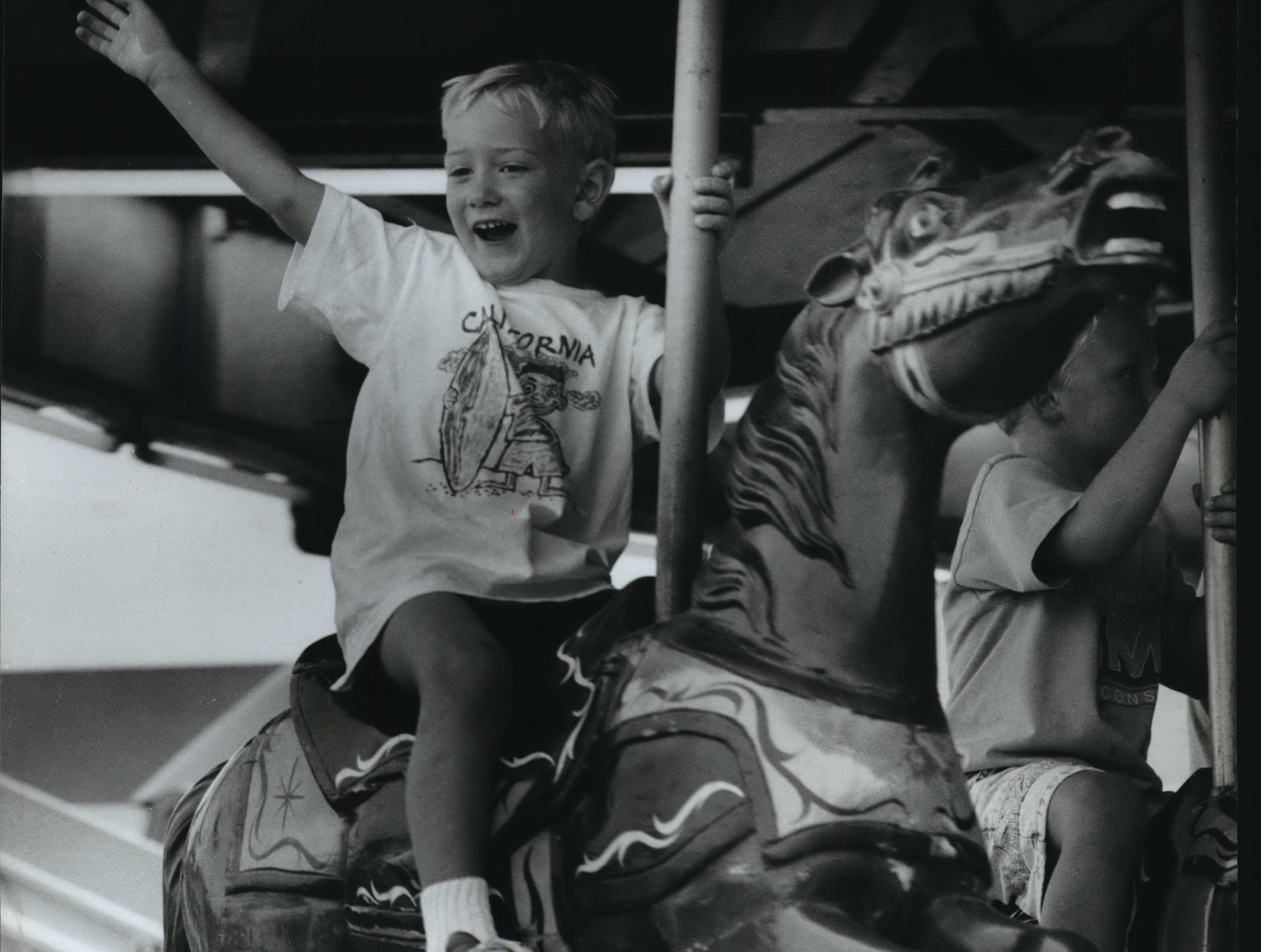 The Washington County Junior Fair offered plenty of entertainment for those who stopped by during the fair's four-day run in Slinger. Justin Loduha, 4, of West Bend, waves to his parents from the carousel.
