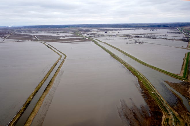 Levees built to protect fields from floods, are seen in flooded fields near Pacific Junction, Iowa. Extensive flooding along the Missouri River has led to blistering criticism of the Army Corps of Engineers' management of dams and levees that control conditions along the waterway.