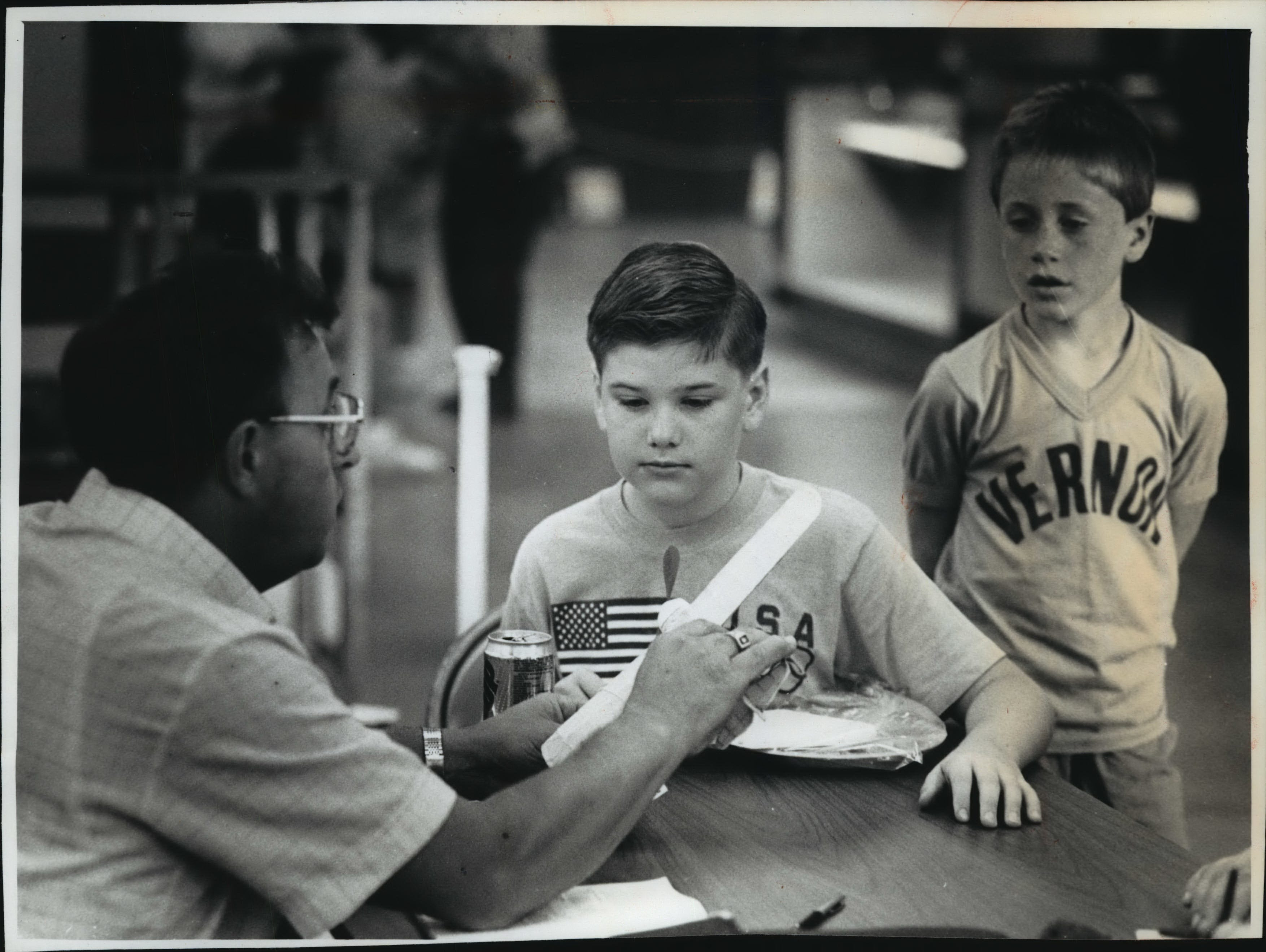 Carl Smith, a retired 4-H youth adviser, evaluates a Taylor Craft airplane built by Ted Grant, 12, of Sussex. Grant entered the plane Wednesday in the home craft display for youngsters at the Waukesha County Fair. The fair continues through Sunday with activities that include national touring performers, a tractor pull, draft horse shows and fireworks.
