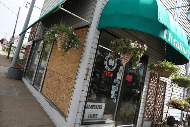 Something broke the display window at Florafino's on Maple Avenue in Zanesville, but no one is sure what.