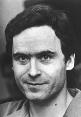 The real Ted Bundy, shown in this July 1986 file photo taken in Tallahassee, Fla., smiles and turns his eyes to the camera.