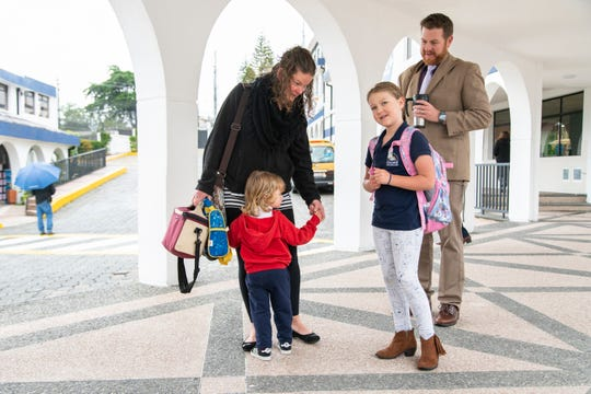 Kip Mapstone, right, arrives at Academia Cotopaxi with his wife Becky and their two children Marlee and Loen.
