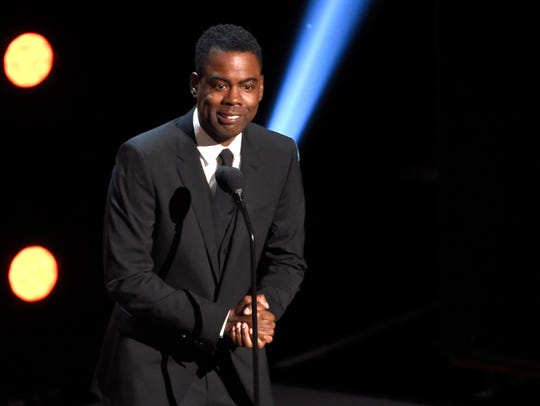 Chris Rock presents the award for outstanding comedy series at the 50th annual NAACP Image Awards at the Dolby Theatre in Los Angeles.
