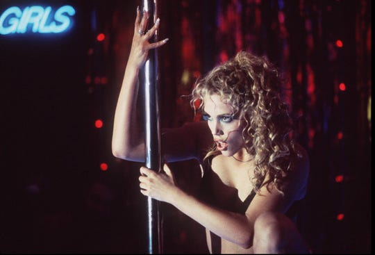"Elizabeth Berkley in the movie ""Showgirls."""