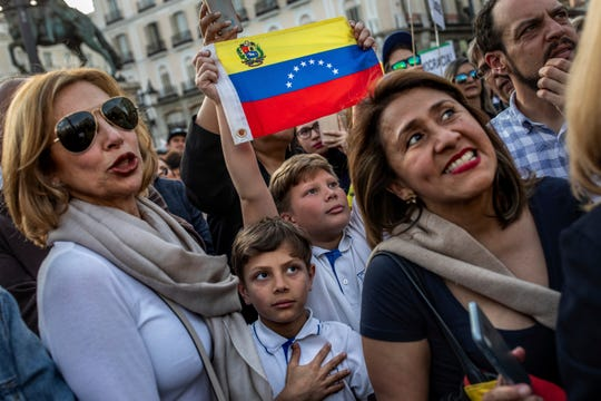 Supporters of Venezuelan opposition leader  Juan Guaido gather in Madrid, Spain, Tuesday, April 30, 2019. Thousands of Venezuelans have migrated to Spain in recent years or are seeking asylum in the country, including prominent members of the opposition and former officials who worked closely with late Venezuelan President Hugo Chavez. More than 177,000 Spaniards live in Venezuela.