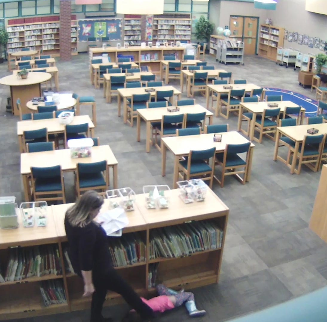 Screenshot from video of Kansas elementary school teacher Crystal Smith when she appears to be kicking a student.