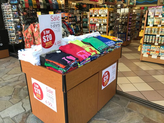 ABC Stores, scattered throughout Honolulu, offer a variety of Hawaii souvenirs, including bargain T-shirts.