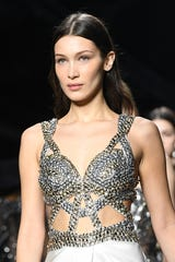 Bella Hadid issued an apology in both English and Arabic Monday after social media users took issue with a photo she posted to Instagram over the weekend.