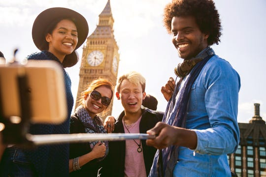 ulti ethnic group of friends taking a selfie with BigBen in Central London