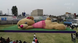 Residents in Mexico enter the Guinness Book of World Records with a giant teddy bear, measuring about 65 feet and 8,000 pounds.