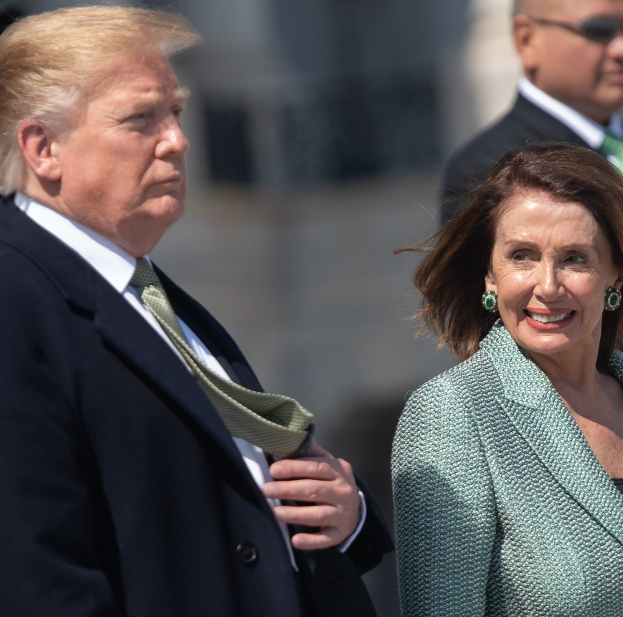 "(FILES) In this file photo taken on March 14, 2019 US President Donald Trump walks alongside Speaker of the House Nancy Pelosi as he departs following the Friends of Ireland Luncheon in honor of Irish Prime Minister Leo Varadkar at the US Capitol in Washington, DC. - Top US Democrats on March 22, 2019, demanded the full special counsel report on Russian interference in the 2016 election be released publicly with no ""sneak preview"" for President Donald Trump. Many of the party's challengers for the 2020 presidential nomination, including senators Bernie Sanders and Kamala Harris, swiftly joined calls for full transparency after Special Counsel Robert Mueller submitted his report to Attorney General Bill Barr. ""It is imperative for (Attorney General Bill) Barr to make the full report public and provide its underlying documentation and findings to Congress,"" House Speaker Nancy Pelosi and Senate Minority Leader Chuck Schumer said in a joint statement. (Photo by SAUL LOEB / AFP)SAUL LOEB/AFP/Getty Images ORIG FILE ID: AFP_1EY9BK"