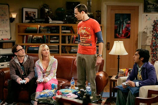 You've come a long way, physicists! Johnny Galecki, left, Kaley Cuoco, Jim Parsons and Kunal Nayyar act out a scene from the first season of 'The Big Bang Theory' in 2007.