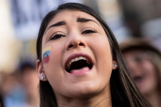 A Venezuelan woman shouts slogans in favor of Venezuelan opposition leader  Juan Guaido in Madrid, Spain, Tuesday, April 30, 2019. Thousands of Venezuelans have migrated to Spain in recent years or are seeking asylum in the country, including prominent members of the opposition and former officials who worked closely with late Venezuelan President Hugo Chavez. More than 177,000 Spaniards live in Venezuela.