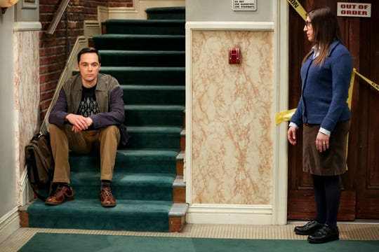 Spouses Sheldon (Jim Parsons), left, and Amy (Mayim Bialik) have a conversation in the apartment stairwell near the never-working elevator in a recent episode of CBS's 'The Big Bang Theory.'