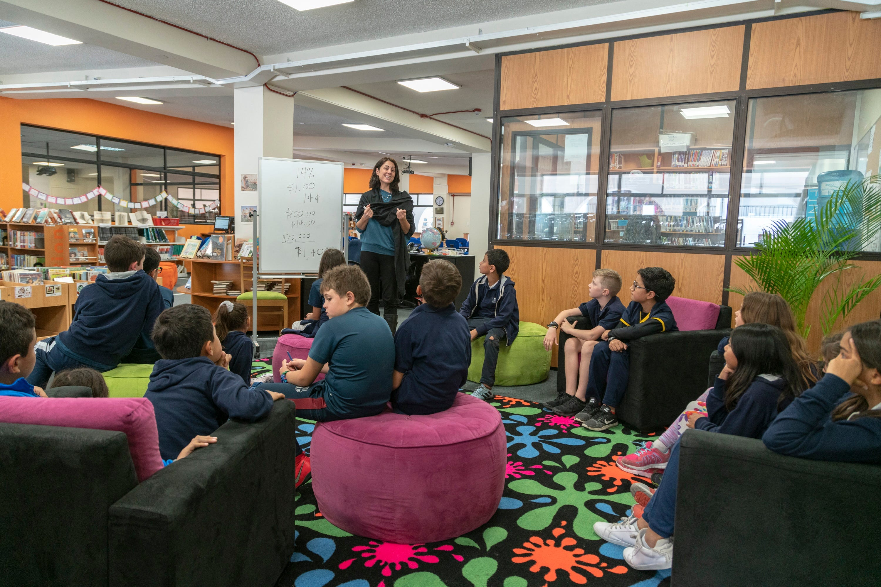 Jill Egan, a librarian, works with a group of students Academia Cotopaxi.