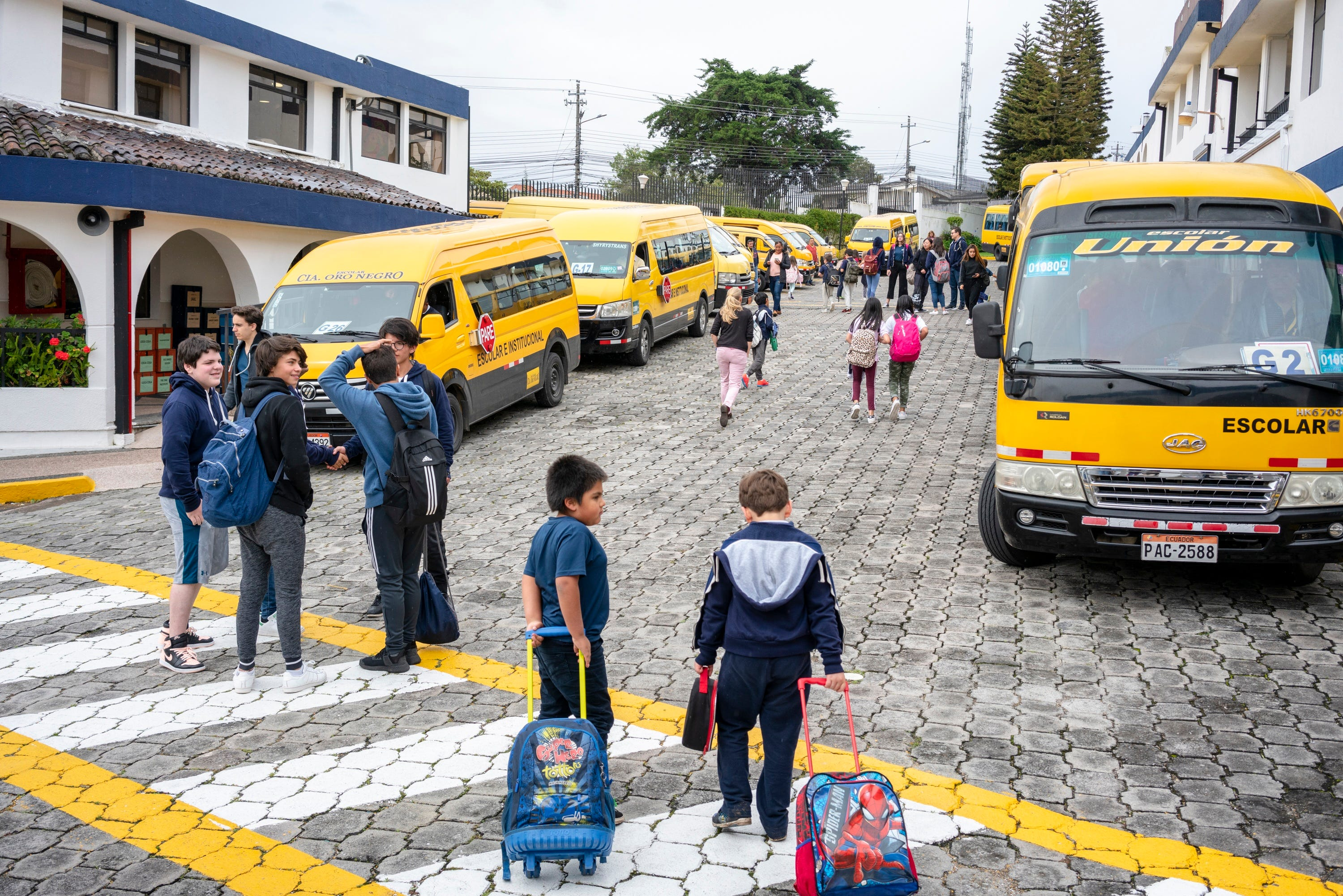Students are seen outside of Academia Cotopaxi in Quito, Ecuador. As American teachers continue to protest low wages, large class sizes and competition from charter schools, thousands are opting to leave their classrooms -- and the country -- for assignments in international schools abroad.