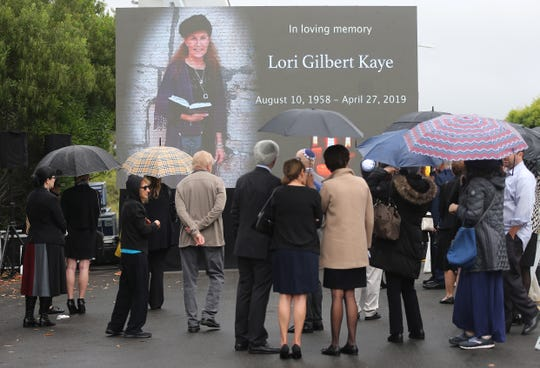 Mourners gather to watch a video broadcast in the overflow section during the funeral for Lori Gilbert-Kaye on April 29, 2019 in Poway, Calif.