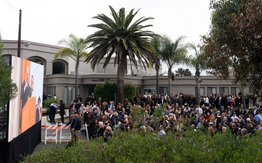 People attend a funeral service on April 29, 2019, for Lori Gilbert-Kaye in Poway, Calif.