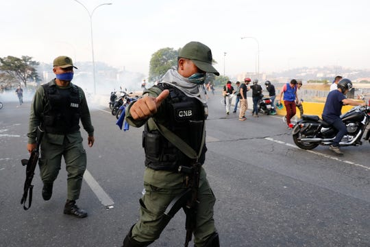 Members of the Bolivarian National Guard took part in an uprising outside La Carlota air base in Caracas, Venezuela, on Tuesday.