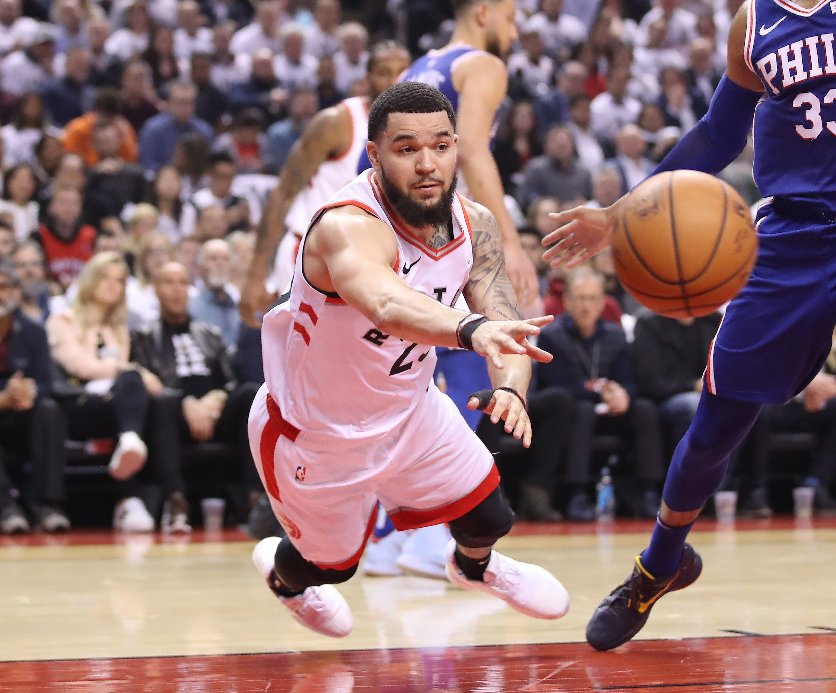 April 29: Raptors guard Fred VanVleet passes while falling to the floor during Game 2 against the 76ers.