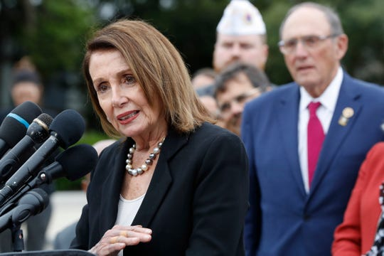 House Speaker Nancy Pelosi of Calif., left, speaks, with House Veterans' Affairs Ranking Member Phil Roe, R-Tenn., at right, during a news conference about veteran suicide prevention, Monday April 29, 2019, at the House Triangle on Capitol Hill in Washington.