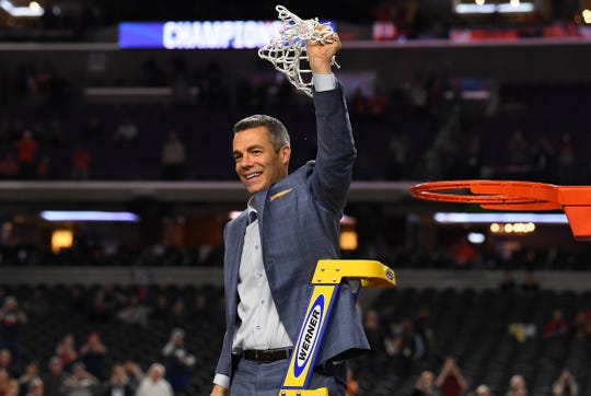 Apr 8, 2019; Minneapolis, MN, USA; Virginia Cavaliers head coach Tony Bennett waves the net to fans after defeating the Texas Tech Red Raiders in overtime in the championship game of the 2019 men's Final Four at US Bank Stadium. Mandatory Credit: Robert Deutsch-USA TODAY Sports