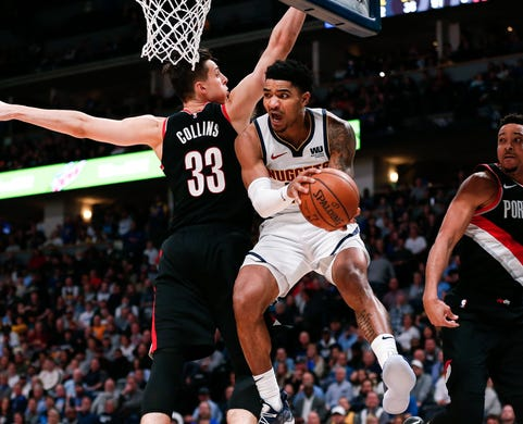 April 29: Nuggets guard Gary Harris (14) drives to the bucket for the up-and-under score past Trail Blazers defender Zach Collins (33) during Game 1.