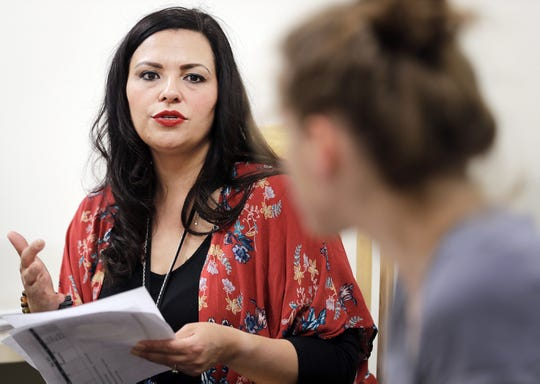 Teresa Fernandez, a home consultant with Outagamie County's Children, Youth and Families Division talks with a family during a supervised family interaction at the Outagamie County Government Center in Appleton.