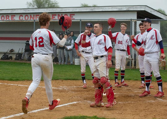 Jackson Liberty's evin Ritz is greeted by team mate David Melfi after hitting a home run in the fourth inning of Jackson Liberty's 5-2 win over Point Pleasant Boro Wednesday. Melfi had homered earlier in that inning.