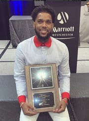 Myles Powell holds the Haggerty Award