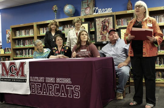 "Kathie Walker-Millar, McMurry University department head and professor of art, right, talked Monday about the talents of Hawley High senior Sally Stokes, center, who was awarded a ""full ride"" to the college."