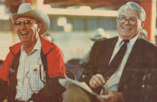 Myrle Greathouse, right, shares a laugh with Wayne Moore in November 1989 at the annual West Texas Rehabilitation Center auction. On this day, they bid $580 for leftover brisket and sausage to benefit the WTRC.