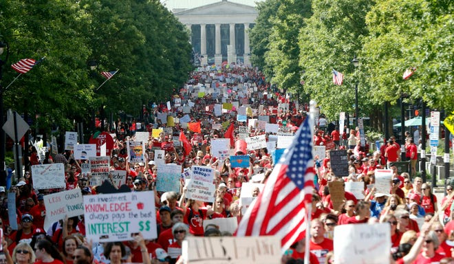 Thousands of teachers, other school employees and their supporters marched up Fayetteville Street through downtown Raleigh on May 1, 2019. North Carolina teachers took to the streets Wednesday for the second year in a row with hopes that a more politically balanced legislature will be more willing to meet their demands.