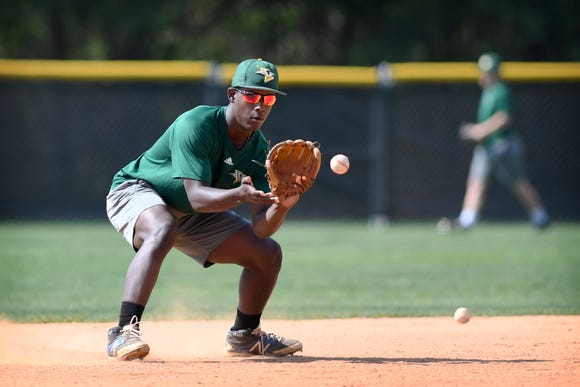 Christ School's Isaih Lowe catches a popped up ground ball during a practice drill on April 29, 2019.
