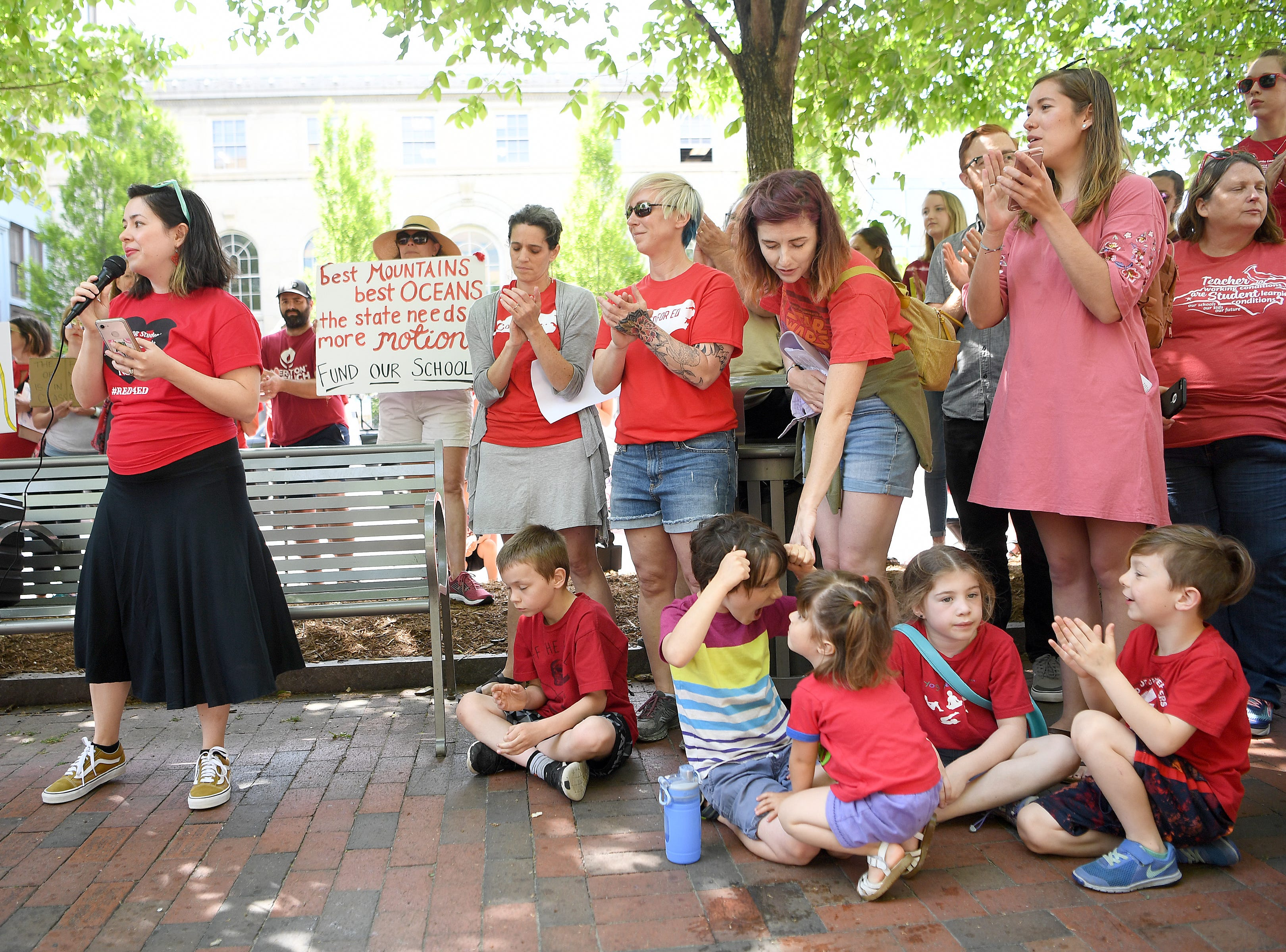Kimberly Eggett, a Claxton Elementary School teacher, speaks to the crowd during the Asheville rally for public education at the Vance monument on May 1, 2019. The rally coincided with the NC Association of EducatorsÕ Day of Action in Raleigh.