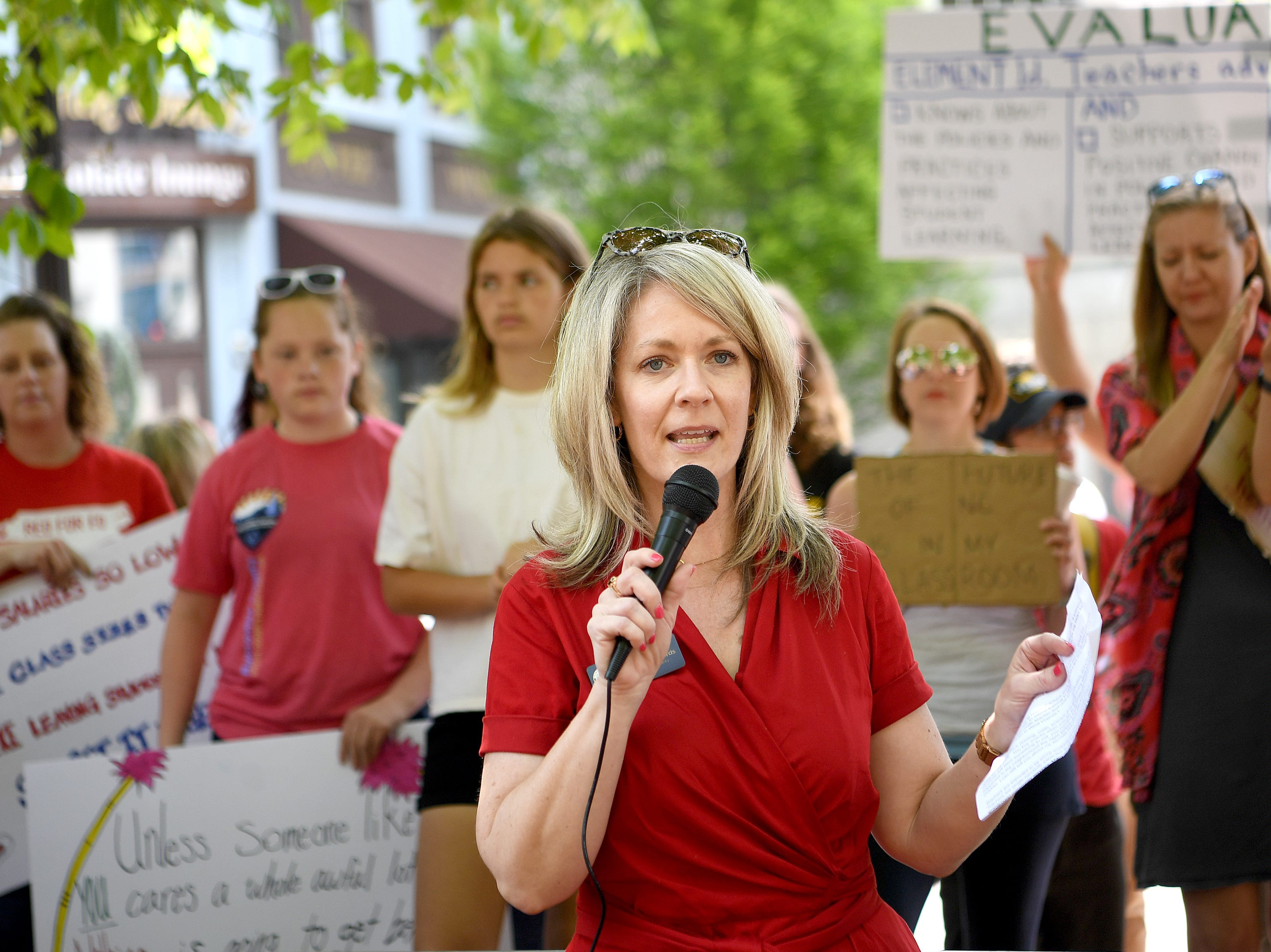 Buncombe County commissioner Amanda Edwards speaks to the crowd during the Asheville rally for public education at the Vance monument on May 1, 2019. The rally coincided with the NC Association of EducatorsÕ Day of Action in Raleigh.