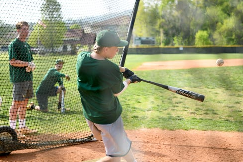Christ School's Webb Hughes hits a ball during a hitting game during practice on April 29, 2019.