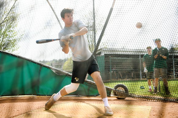 Christ School's Parker Johnson takes a swing at a ball during a hitting game during practice on April 29, 2019.