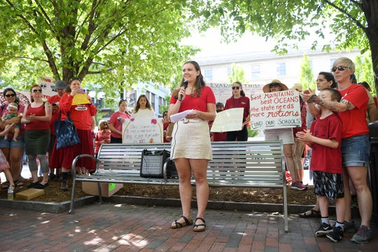 Isabelle Freireich, president-elect of the Asheville High School student government, speaks to the crowd during the Asheville rally for public education at the Vance monument on May 1, 2019. The rally coincided with the NC Association of EducatorsÕ Day of Action in Raleigh.