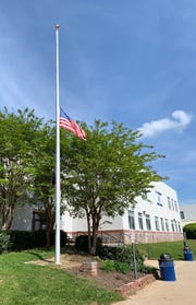 The flag at T.C. Roberson High School was at half-staff May 1 in honor of graduate Riley Howell. Howell, 21, was killed in an April 30 shooting on UNC Charlotte's campus.